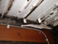 Closeup of water damage on captain's cabin ceiling